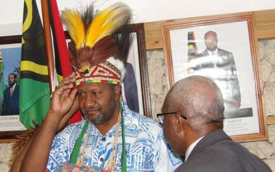 Vanuatu prime minister Charlot Salwai accepts traditional head dress from the United Liberation Movement for West Papua. Photo: Len Garae